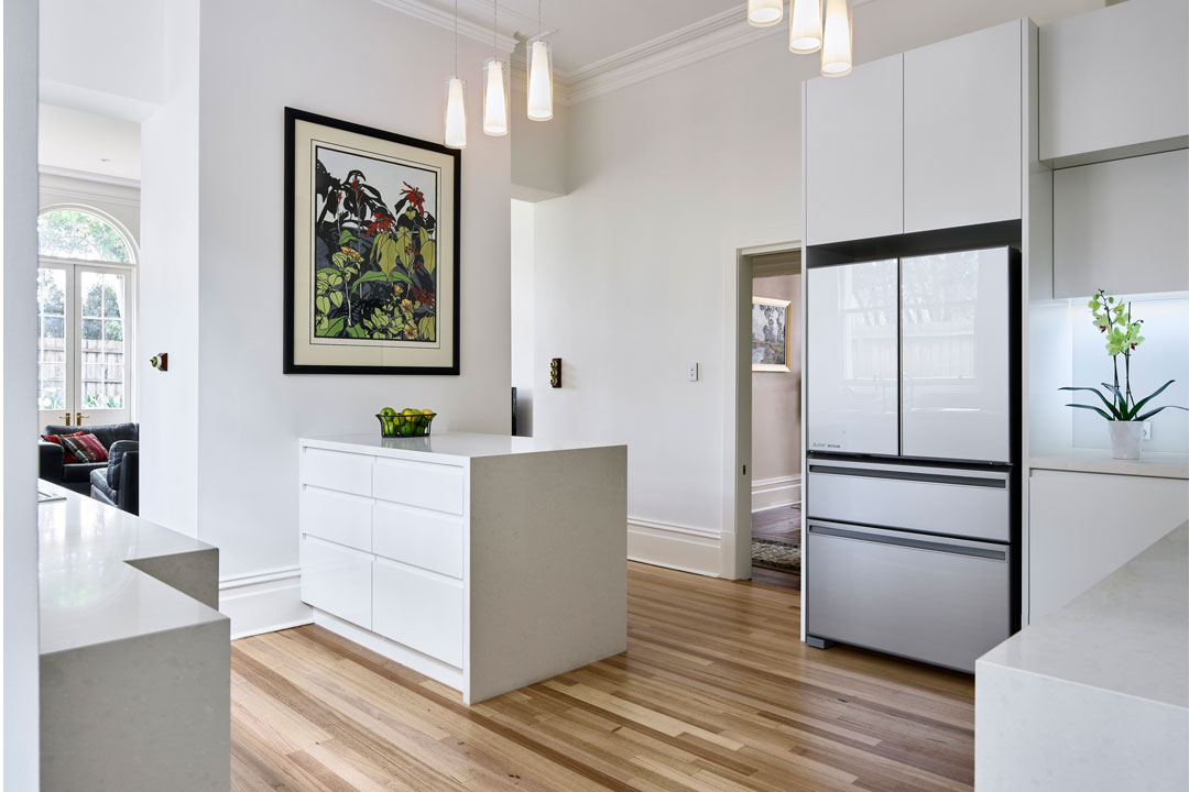 Mint Kitchen Group kitchen with timber flooring and white cabinetry