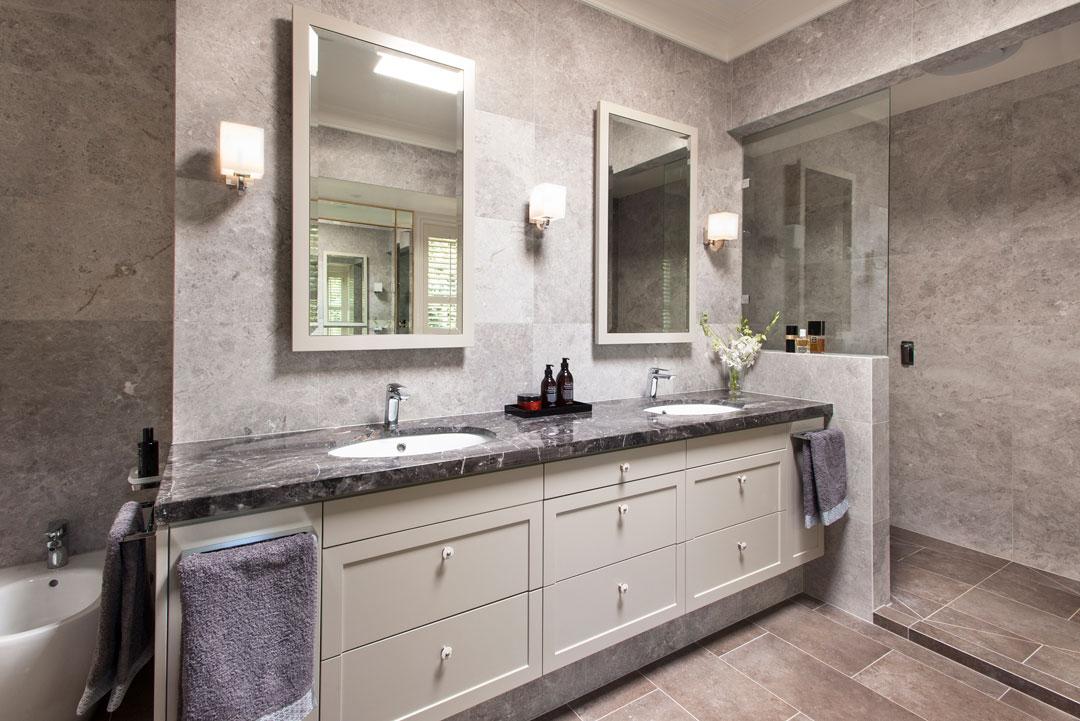 Sally Feeney Interior Design bathroom with stone-topped vanity