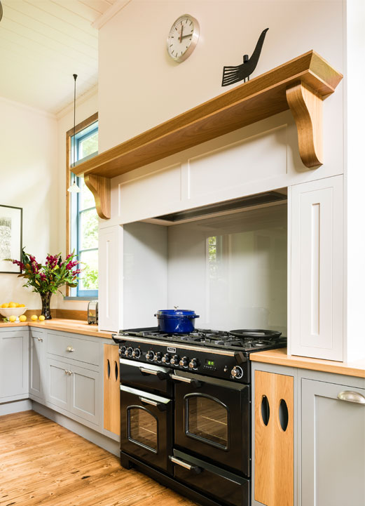 Smith & Smith Kitchens farmhouse style kitchen with stove in chimney alcove